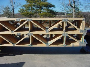 Floor trusses stacked on each other. Picture from this website.